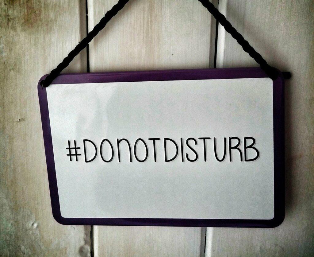 Do not disturb sign in front of a door